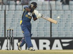 Sri Lanka's Kusal Perera plays a shot during the first Twenty 20 cricket match against Bangladesh in Chittagong, Bangladesh, Wednesday, Feb. 12, 2014. Sri Lanka won by 2 runs. (AP Photo)