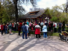 Participants in a North East Winnipeg Historical Society walking tour in 2012 congregate in front of one of the sites.