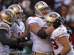 San Francisco 49ers fullback Bruce Miller, right, celebrates his touchdown with teammates, from left, Delanie Walker, Alex Smith and Joe Staley in the first half of an NFL football game against the Washington Redskins in Landover, Md., Sunday, Nov. 6, 2011. (AP Photo/Pablo Martinez Monsivais)