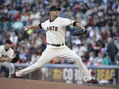 San Francisco Giants starting pitcher Ryan Vogelsong throws against the Cincinnati Reds in the first inning of their baseball game Thursday, June 26, 2014, in San Francisco. (AP Photo/Eric Risberg)