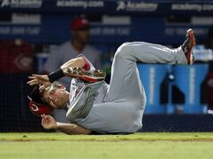 Cincinnati Reds catcher Devin Mesoraco falls after rounding third base to score on a double by teammate Billy Hamilton in the seventh inning of a baseball game against the Atlanta Braves Friday, April , 25, 2014 in Atlanta. (AP Photo/John Bazemore)