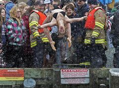 A reveller takes the plunge during the annual New Year's polar bear dip in Herring Cove, N.S. on Tuesday, Jan.1, 2013. THE CANADIAN PRESS/Andrew Vaughan