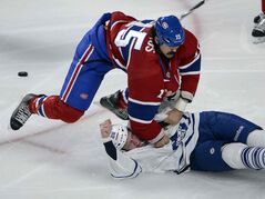 The Canadiens' George Parros and the Maple Leafs' Colton Orr (28) fight in Montreal Tuesday.