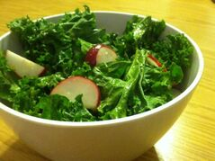 A tip for preparing large kale leaves for use in salads: Massage the entire leaf with a little oil, then chop it.
