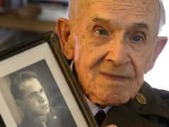 Eighty-nine-year-old Roland Chaisson, who stormed Normandy on D-Day when Germans killed half his squad before they could reach shore, poses for photographs in his home in Metairie, La., Wednesday, June 4, 2014. Chaisson is among D-Day veterans who will describe that day Friday and Saturday at the National World War II Museum. More than 15 hours of observances are planned Friday, the invasion's 70th anniversary. (AP Photo/Gerald Herbert)