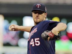 Minnesota Twins pitcher Phil Hughes throws against the Texas Rangers in the first inning of a baseball game Tuesday, May 27, 2014, in Minneapolis. (AP Photo/Jim Mone)