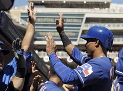 Texas Rangers' Leonys Martin is welcomed in the dugout after he scored the go-ahead run on a sacrifice fly by Rougned Odor in the eighth inning of a baseball game against the Minnesota Twins, Thursday, May 29, 2014, in Minneapolis. The Rangers won 5-4. (AP Photo/Jim Mone)