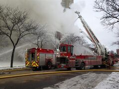 Firefighters work the scene where a fire engulfed several apartment units in the Cedar Riverside neighborhood, in Minneapolis, Wednesday, Jan. 1, 2014. Authorities say at least 13 people have been hurt. (AP Photo/Star Tribune, McKenna Ewen)