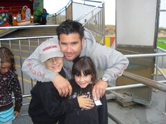 This undated image provided Tuesday April 5, 2011 by John Stow shows Bryan Stow holding his 12-year-old son and 8-year-old daughter. Stow, who became a symbol of violence at sporting events, suffered severe brain damage after being beaten by two Dodgers fans who pleaded guilty to criminal charges in the attack. A lawyer for the San Francisco Giants fan who was attacked and gravely injured at Dodger Stadium plans to call former Dodgers owner Frank McCourt as a witness Friday June 13, 2014 in a negligence lawsuit against the team and McCourt. (AP Photo/John Stow)