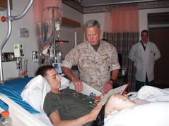 ADVANCE FOR WEEKEND EDITIONS, JUNE 1-2 - In this 2009 photo provided by Monster Energy, Jesse Williamson receives his purple heart citation from Commandant General Amos of the USMC at Walter Reed National Military Medical Center in Bethesda, Md. Next weekend, Williamson will attempt to become the first double amputee to compete in the Baja 500 off-road race through Mexico. (AP Photo/Monster Energy)