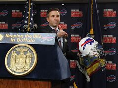Buffalo Bills CEO Russ Brandon gestures during a news conference announcing details of a 10-year lease to keep the NFL football team in Orchard Park, Friday, Dec. 21, 2012, in Orchard Park, N.Y. (AP Photo/Bill Wippert)