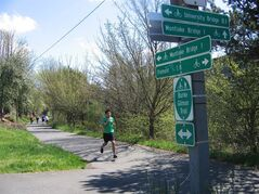 In this April 2012 photo released by Blythe Keller, shows Andy Lin, of Seattle, running on the Burke-Gilman Trail in Seattle. The trail was one of the nation's first rail trails, according to the Rails to Trails Conservancy. Thanks partly to federal legislation and partly to a push by communities and private groups to open up more areas for recreation, the rails-to-trails movement has taken off. The Rails to Trails Conservancy counts more than 1,600 trails covering 20,000 miles and are used by millions of people each year. There are trails in all 50 states. (AP Photo/Blythe Keller)