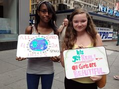 Britney Franco, 13, and Hannah Stydahar, 14, during a protest Wednesday, near the offices of Teen Vogue in the Times Square section of New York. (AP Photo/Leanne Italie)
