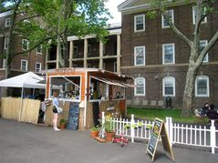 This June 6, 2014 photo shows a food vendor on Governors Island in New York City. The island, a former Coast Guard facility, is now a national park and recreation site, open daily to visitors through the summer. It's dotted with green lawns, outdoor art and historic buildings and it offers a variety of food, events and activities, along with scenic views of Manhattan. (AP Photo/Beth J. Harpaz)