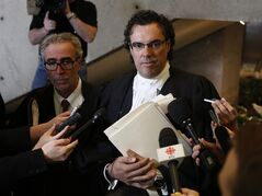 Michel Swanston (right), the lawyer for Senator Patrick Brazeau, speaks to the media at the courthouse in Gatineau, Que., on Friday, March 22, 2013. Senator Brazeau did appear in court and the case has been put over until June 10. THE CANADIAN PRESS/ Patrick Doyle