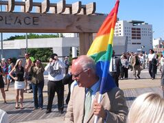 Atlantic City Mayor Don Guardian holds a flag in Atlantic City, N.J., Monday, June 16, 2014. Atlantic City is planning a series of events to attract gay tourists, who are becoming an increasingly important part of the resort's growth strategy. (AP Photo/Wayne Parry)