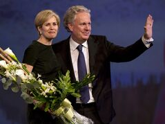 Quebec Liberal Party leader Jean Charest and his wave, Michele Dionne, wave to the crowd after a tribute in his honour at the party's convention Saturday, March 16, 2013 in Montreal.THE CANADIAN PRESS/Ryan Remiorz