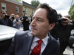 Montreal Mayor Michael Applebaum gets into a car outside police headquarters in Montreal, Monday, June 17, 2013. Applebaum was arrested earlier as part of a bribery case. THE CANADIAN PRESS/Ryan Remiorz