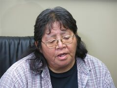 Residential school survivor Connie Calling Last, speaks to reporters at a Law Society of Alberta hearing in Calgary Friday, June 13, 2014 about lawyer David Blott, who was disbarred for his handling of claims. THE CANADIAN PRESS/Bill Graveland