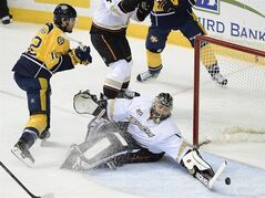Nashville Predators forward Mike Fisher (12) has his shot blocked by Anaheim Ducks goalie Jonas Hiller (1), of Switzerland, in the first period of an NHL hockey game on Saturday, Feb. 8, 2014, in Nashville, Tenn. (AP Photo/Mark Zaleski)