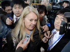 FILE - In this Jan. 18, 2013 file photo, officials inspect an All Nippon Airways Boeing 787 which made an emergency landing at Takamatsu airport in Takamatsu, western Japan. The joint U.S. and Japanese investigation into the plane's battery problems has shifted from the battery-maker to the manufacturer of a monitoring system Monday, Jan. 28, 2013. (AP Photo/Kyodo News) JAPAN OUT, MANDATORY CREDIT, NO LICENSING IN CHINA, HONG KONG, JAPAN, SOUTH KOREA AND FRANCE
