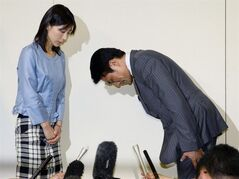 "Tokyo city assemblyman Akihiro Suzuki bows to his female counterpart Ayaka Shiomura for an apology at Tokyo Metropolitan City Hall in Tokyo Monday, June 23, 2014. Suzuki from Prime Minister Shinzo Abe's ruling party apologized for throwing one of several sexist hecklings at Shiomura Monday, five days after officials scrambled to identify the voices heard during her speech. A voice from the floor said ""You are the one who should get married first,"" followed by laughter and more hecklings including ""She must be single"" and ""Can't you have babies?"" as Shiomura asked Tokyo's maternity support measures. (AP Photo/Kyodo News) JAPAN OUT, CREDIT MANDATORY"