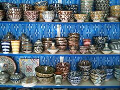 Painted pottery for sale in the souks of Essaouira, Morocco, where visitors can haggle for their souvenirs.