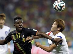 Belgium's Divock Origi pushes off South Korea's Kim Young-gwon during the group H World Cup soccer match between South Korea and Belgium at the Itaquerao Stadium in Sao Paulo, Brazil, Thursday, June 26, 2014. (AP Photo/Thanassis Stavrakis)