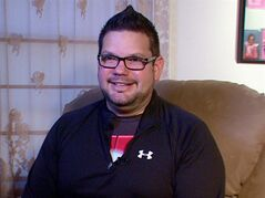 This photo from video taken Oct. 9, 2013 shows Tim Davis in Beaver Falls, Pa. Davis uses several apps and three wearable devices to track his physical activity, vitals and calorie intake. When Davis tipped the scales at 318 pounds two years ago, he bought a Fitbit gadget to track his physical activity and the Lose It! app on his phone to track calories. He bought a Wi-Fi-enabled scale that published his daily weight on his Twitter feed and turned to other apps to track his pulse, blood pressure, daily moods and medications. At one point, Davis said he was using 15 different apps and gadgets, which he said helped him drop 64 pounds by that following year. (AP Photo/Noel Waghorn)