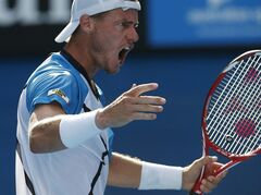 Lleyton Hewitt of Australia reacts between points during his first round match against Andreas Seppi of Italy at the Australian Open tennis championship in Melbourne, Australia, Tuesday, Jan. 14, 2014. (AP Photo/Eugene Hoshiko)
