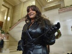 Terri-Jean Bedford talks to reporters at the Supreme Court of Canada in Ottawa Friday morning, Dec. 20, 2013 after learning Canada's highest court struck down the country's prostitution laws in their entirety in a unanimous 9-0 ruling. THE CANADIAN PRESS/Adrian Wyld