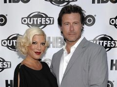 Actress Tori Spelling, left, and actor Dean McDermott arrive at the premiere of the feature film