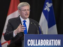 Prime Minister Stephen Harper responds to media in Roberval, Que., Wednesday June 25 2014.. THE CANADIAN PRESS/Clement Allard