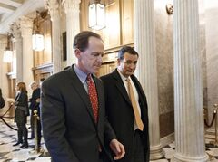 Sen. Pat Toomey, R-Pa., left, and Sen. Ted Cruz, R-Texas, right, arrive at the Senate on Capitol Hill in Washington, Tuesday, Jan. 7, 2014, for a procedural vote on legislation to renew jobless benefits for the long-term unemployed. THE CANADIAN PRESS/AP, J. Scott Applewhite