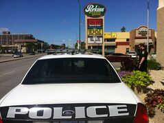 Police taped off a Perkins restaurant on Ness Avenue Thursday morning as they investigated what they described as a suspicious package left outside the restaurant.
