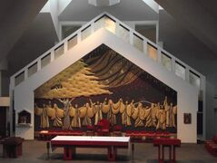The Pentecost tapestry portrays the coming of the Holy Spirit upon the apostles.
