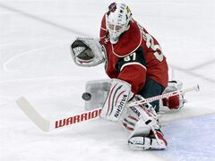 Minnesota Wild goalie Josh Harding (37) stops a shot in the first period of an NHL hockey game against the Vancouver Canucks Thursday, Nov. 3, 2011, in St. Paul, Minn. Harding was named NHL first star of the week Monday after posting three straight victories last week.THE CANADIAN PRESS/AP-Jim Mone