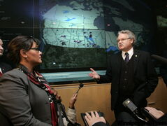 Health Minister Leona Aglukkaq with Chief Public Health Officer Dr. David Butler-Jones, in front of a map indicating H1N1 cases in Canada as they tour the Operations Centre in the National Microbiology Lab.