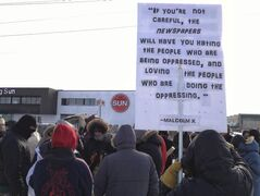 Approximately 75 people gathered outside the offices of the Winnipeg Sun Saturday to protest the Sun Media chain's coverage of Canadian aboriginal issues.