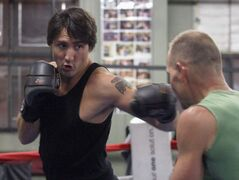 Federal Liberal leadership candidate Justin Trudeau engages in a boxing workout session Friday at the Pan Am Boxing club. He takes part today in a leadership debate at 1 p.m. at the Metropolitan Theatre. He sparred with Pan Am club owner Harry Black .