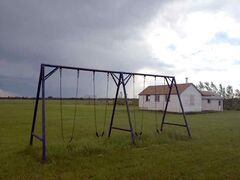 A swing set sits empty.