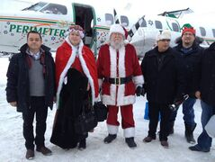 AFN National Chief Shawn Atleo, Mr. and Mrs. Santa Claus, MKO Grand Chief David Harper and MKO Executive Director David Monias help with the Santa Express.