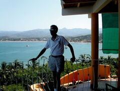 A hilltop restaurant provides a perfect view of picturesque Rincon de Guayabitos and the beach below.