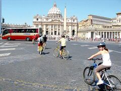 Emma Judd, 11, takes advantage of a rare break in the traffic entering St. Peter's Square during a bicycle tour of Rome and the Vatican. A bicycle tour is an efficient way to tour the city if you're brave enough to face the traffic in Rome.