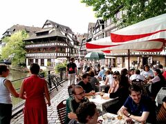 At right, Al fresco dining in the Petite France area of Strasbourg, where  half-timbered houses lend a distinct Swiss look.