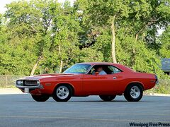 Chris Payne in his restored 1970 Dodge Challenger.