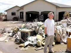Joe Holzer stands in front of a pile of garbage ripped out of his flood damaged home in Minot, N.D. His home was filled three metres deep with water when the Souris River flooded Minot. With little support from government and no flood insurance on the advice of his agent, he's considering walking away from the house, for which he still owes US$70,000.