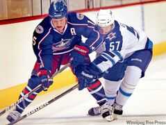 Jets' Jason Gregoire sticks like glue to Blue Jackets' Derek Dorsett in the first period Tuesday.