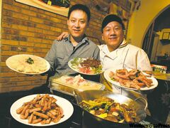 Yougot Chinese Restaurant Inc. owner Zhong Ren and head chef Yang Song with some dishes on the menu and specialty dishes not on the menu.