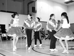 Students prepare for a dance  performance in the Charles Sinclair School gymnasium.